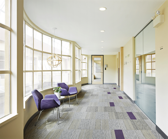 corridor to Housing Central reception with Keilhauer Cahoots furniture and plum accents