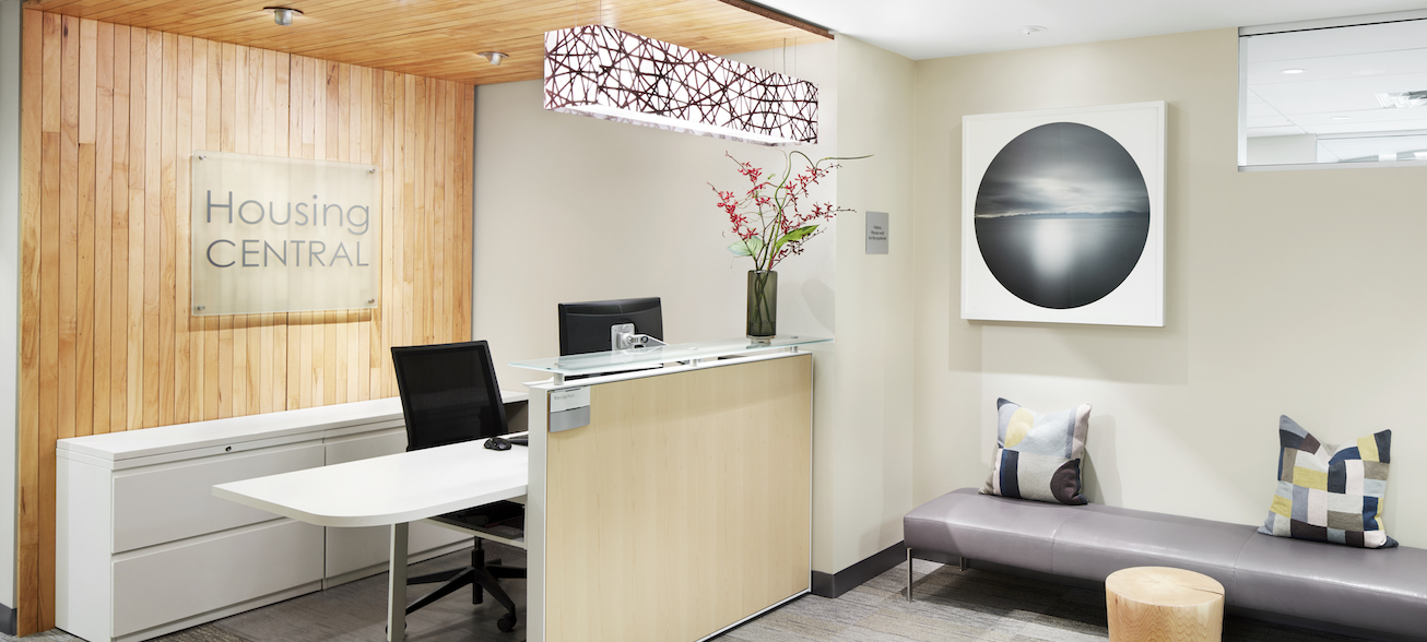 Housing Central Haworth Compose reception desk and 3form LightArt elongated box fixture above